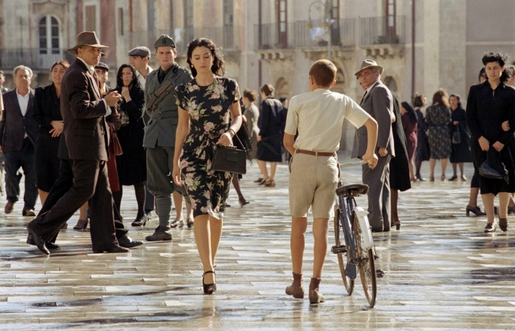 monica bellucci 7 iconic outfits, malena 2000, malena walking, men looking