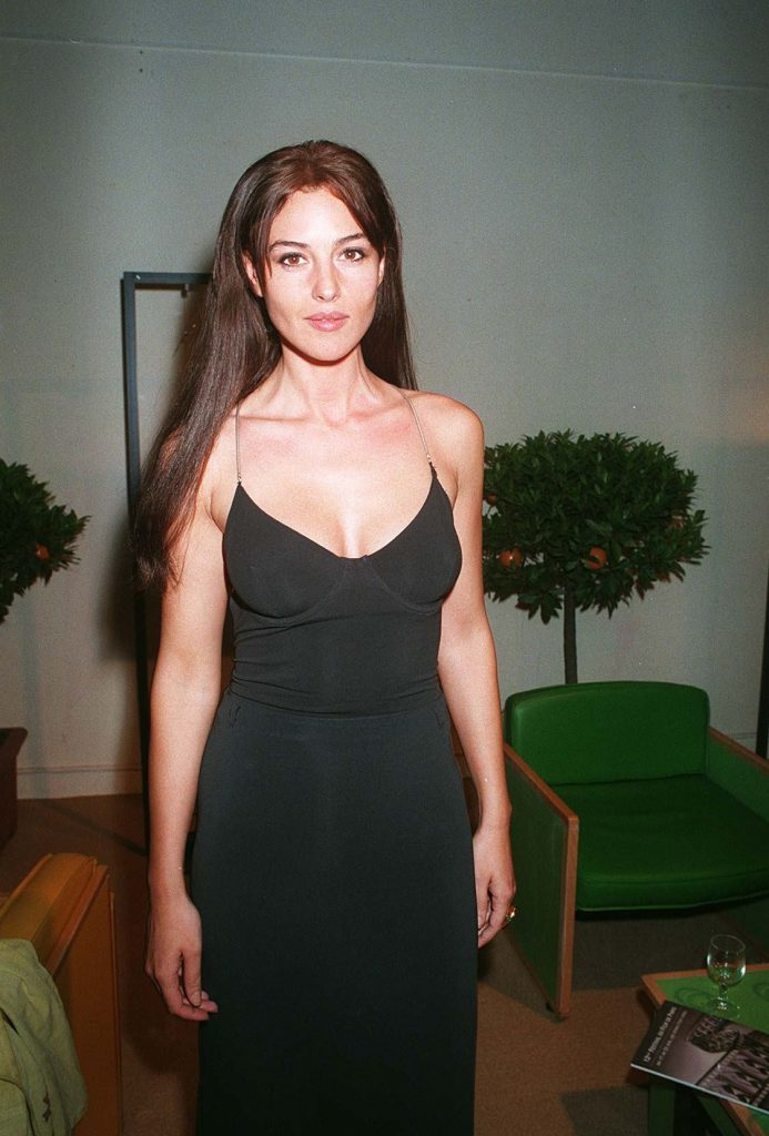 monica bellucci 7 iconic outfits, dobermann premiere 1997, slinky black bustier dress, barely there straps