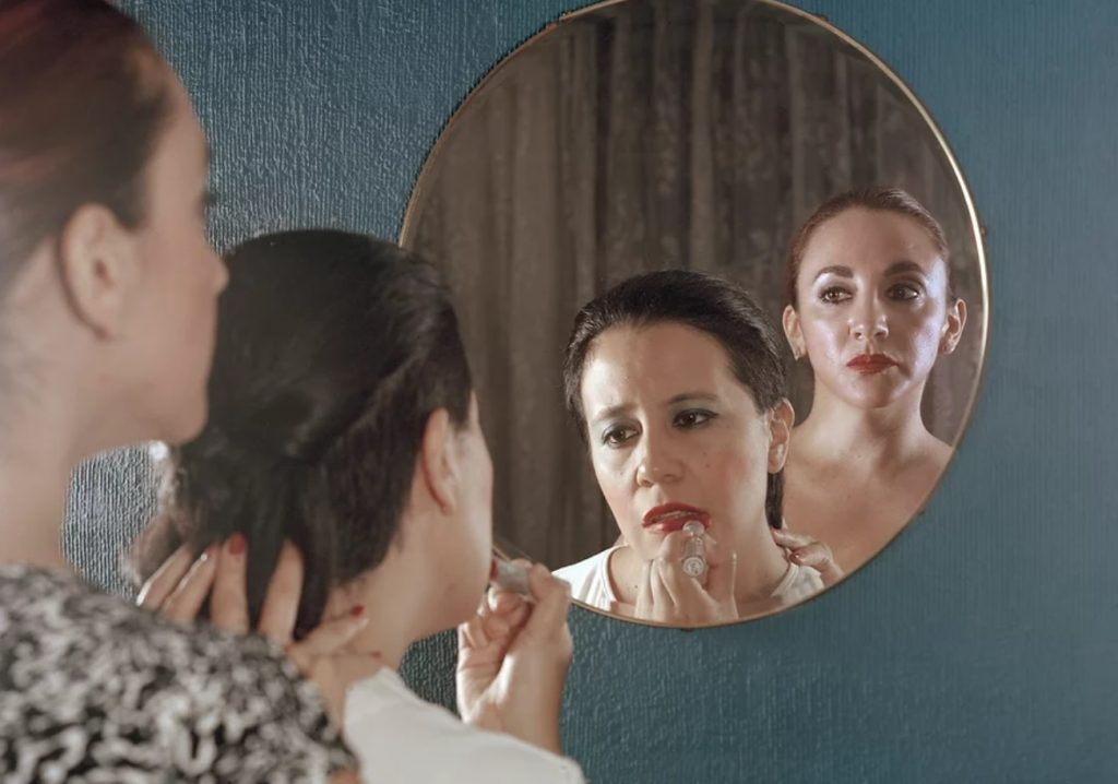 girl getting makeup, in front of mirror, force, ecuador